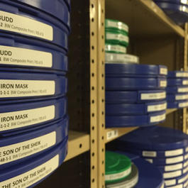 Film reels stacked on shelves