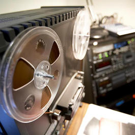 Photograph of an analog reel-to-reel tape recorder and various digital recorders