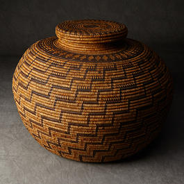Woven patterned lidded basket.