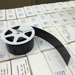 Reel of microfilm on opened drawer