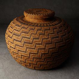Woven patterned lidded basket.