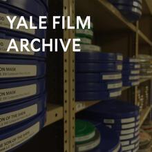 Film reels stacked on shelves